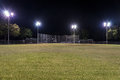 Empty baseball field at night with the lights on Royalty Free Stock Photo