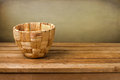 Empty basket on wooden deck table Royalty Free Stock Image