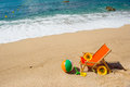 Empty beach chair with flowers and toys at the sea Stock Photo
