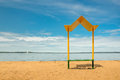 Empty beach with a bench with a canopy on the coast Royalty Free Stock Photo