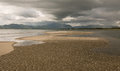 Empty beach before a storm Royalty Free Stock Photo