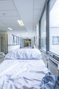 Empty bed gurney in hospital corridor bereavement death or loss concept shot of or stretcher with drip Stock Images