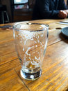 Empty beer glass foam head resides in this after it has been drunk at a restaurant Stock Images