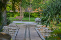 Empty bench and kids train track in Largo Central Park in Largo, Florida, USA Royalty Free Stock Photo