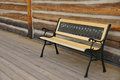 Empty bench log cabin in front of setting on wooden walkway Royalty Free Stock Photos