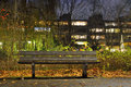 Empty bench in a parc and appartement blocks the distance Royalty Free Stock Photo