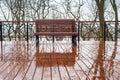 Empty bench rain park nobody Royalty Free Stock Photo