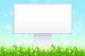 Empty billboard in the grass green with flowers Royalty Free Stock Photography