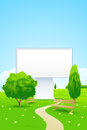 Empty billboard in the park with trees benches and footpath Royalty Free Stock Image