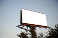 Empty billboard in the sity for your ad on background of sunset sky Royalty Free Stock Image
