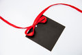 Empty black card with bow on white background Stock Images