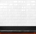Empty black marble table and ceramic tile brick wall in backgrou