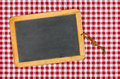 Empty blackboard with chalk on a checkered table cloth red Stock Photo