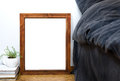 Empty blank vintage wooden frame on a floor, home bedroom interi Royalty Free Stock Photo