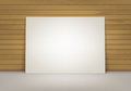 Empty Blank White Mock Up Poster Picture Frame Standing on Floor with Brown Sienna Wooden Wall Front View