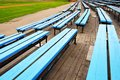 Empty blue color stadium seats Royalty Free Stock Photo