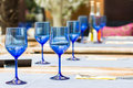 Empty blue glasses on restaurant table elegant Royalty Free Stock Images