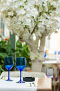 Empty blue glasses on restaurant table elegant Stock Photo