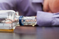 Almost empty bottle of alcohol Stock Photo
