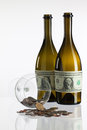 Empty bottles of wine from the label of dollar bill Royalty Free Stock Photo