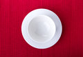 Empty bowl isolated on red background Stock Photography