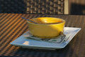 Empty bowl at restaurant with tip an yellow soup sits on an outdoor cafe table money on tray Stock Photos