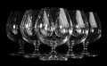 Empty brandy glasses the on black background Stock Photography
