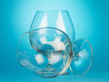 Empty brandy glasses the on blue background Royalty Free Stock Photography