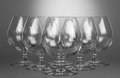 Empty brandy glasses the on grey background Royalty Free Stock Photos