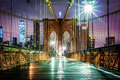 Empty Brooklyn Bridge pedestrian walkway before sunrise Royalty Free Stock Photo