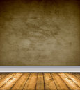 Empty Brown Room With Bare Floors Stock Photo