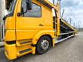 Empty car carrier truck yellow with raised ramp Royalty Free Stock Image
