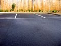 Empty car parks rain pine fence background Stock Photos