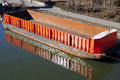 Empty cargo boat berthing at riverside Royalty Free Stock Photo