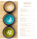 Empty ceramic bowls on bamboo placemat with sample text Royalty Free Stock Photos