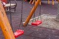 Empty chain swing on kids playground Stock Photo