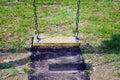 Empty chain swings in children playground Royalty Free Stock Photo