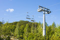 Empty chairlift over the ski resort Royalty Free Stock Photo