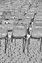 Empty chairs next to each other in lines Stock Photo