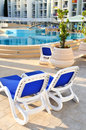 Empty chairs by the pool of  hotel Stock Image