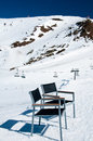 Empty chairs on the ski slope Royalty Free Stock Image