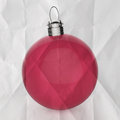 Empty christmas ornament ball on crumpled paper background Royalty Free Stock Photo