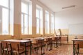 Empty classroom interior wooden desks and chairs Stock Image
