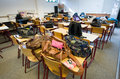 Empty classroom with schoolbags on the tables Royalty Free Stock Photography