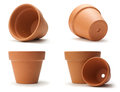 Empty clay pots in different positions over white background Stock Images