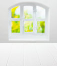 Empty clean white kitchen table and window in front of a cottage pane arched with a view of greenery in summer sunshine as a Stock Photos