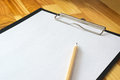 Empty Clipboard, On a wooden table And pencil
