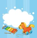 An empty cloud template with a toy horse and a xylophone illustration of Stock Photos