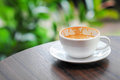 Empty coffee cup on a table near the nature Royalty Free Stock Image