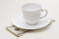 Empty coffee cup and usd close up Stock Photo